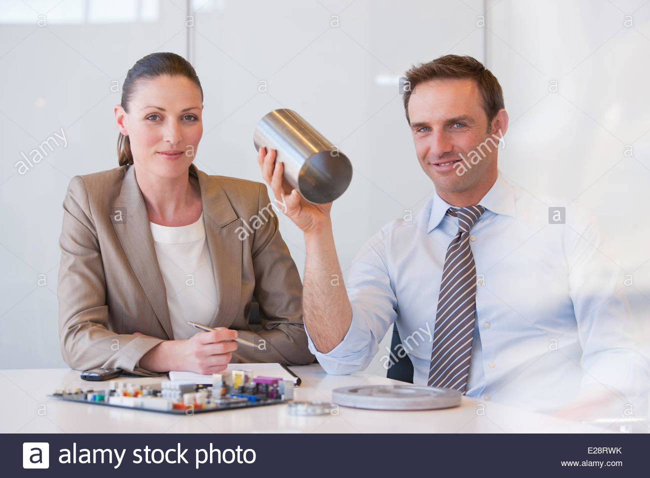 Business people working with cylinder in office - Stock Image