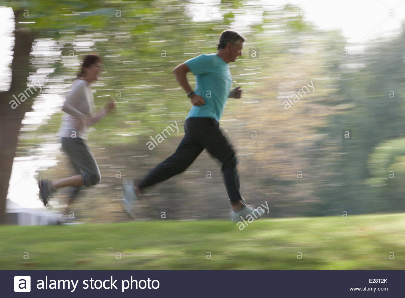 Couple jogging together outdoors - Stock Image