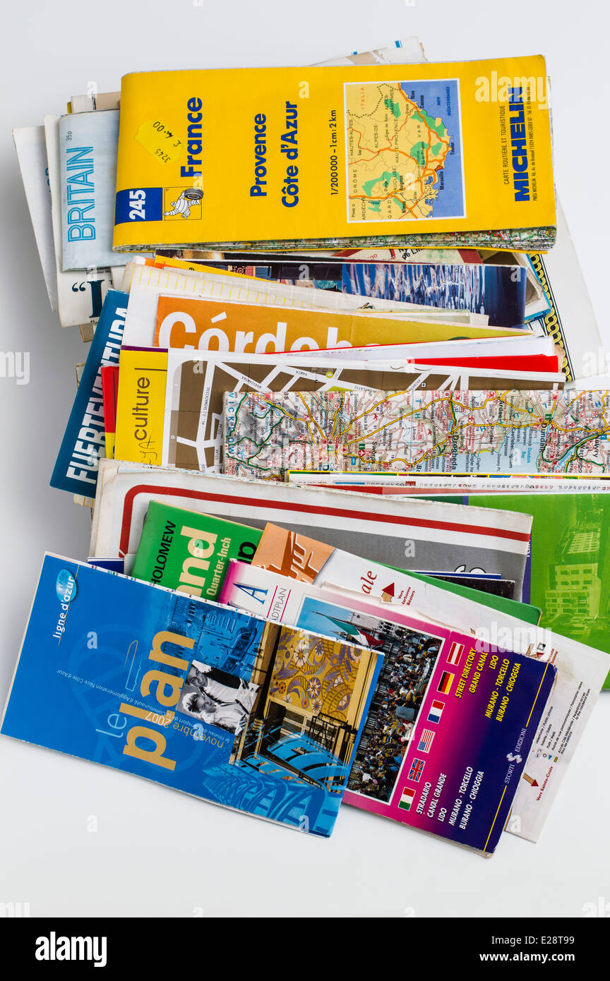 Maps -  a pile of maps of countries and cities - Stock Image