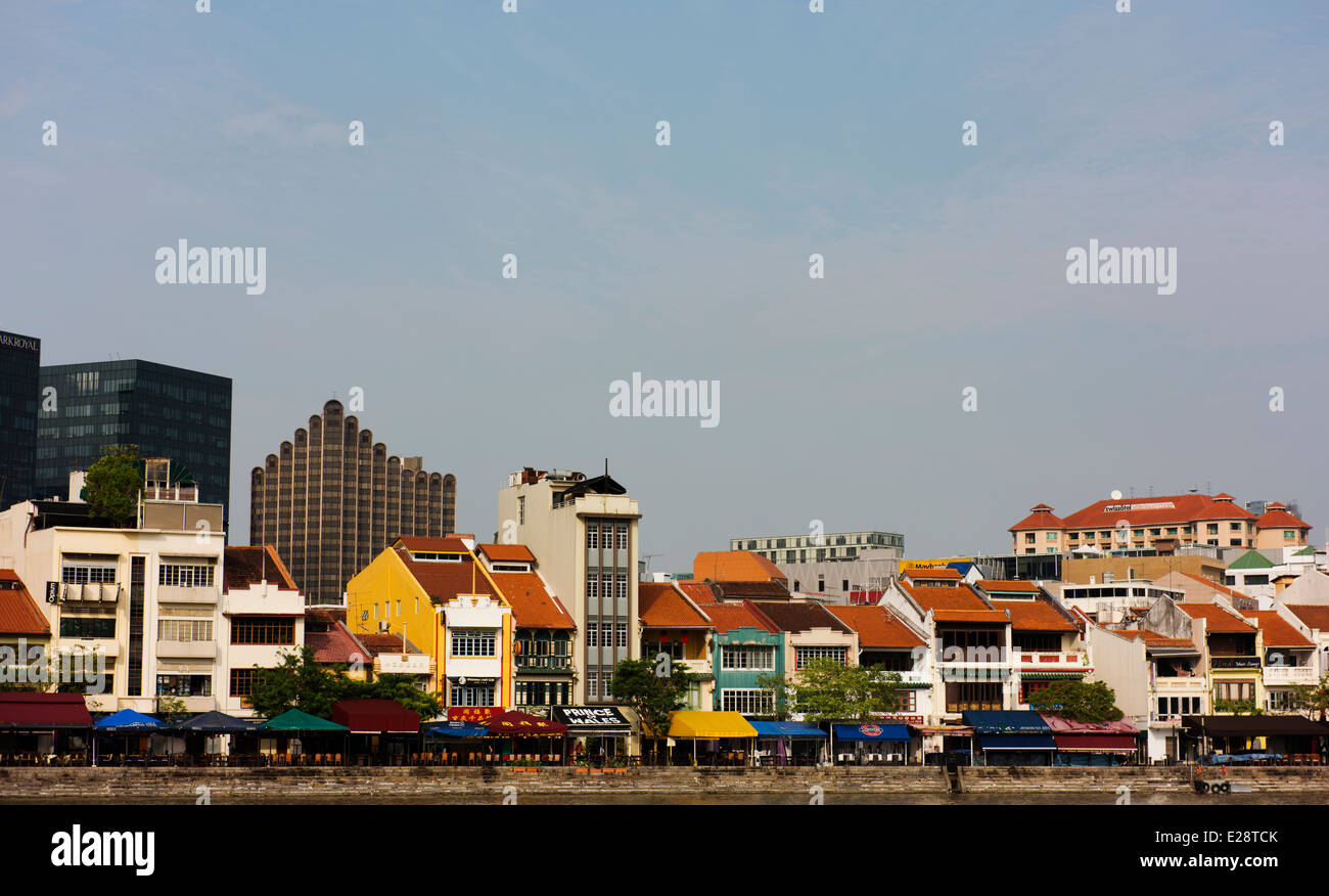 Boat Quay, where restored shophouses along the Singapore River are now restaurants and  bars. - Stock Image