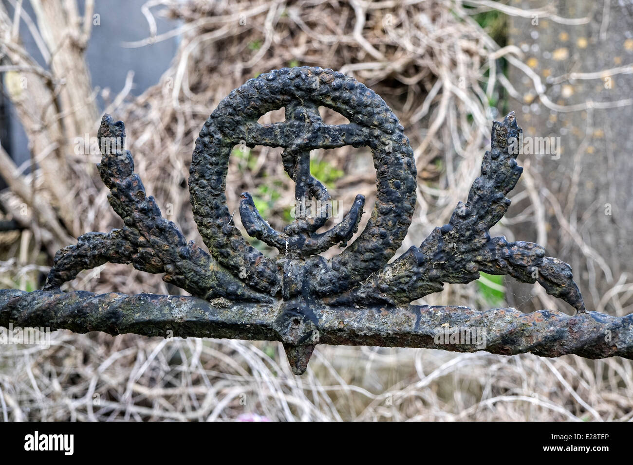 Rusty wrought iron image of the anchor insignia of the British Royal Navy on a grave at Mornington, co. Louth Ireland - Stock Image