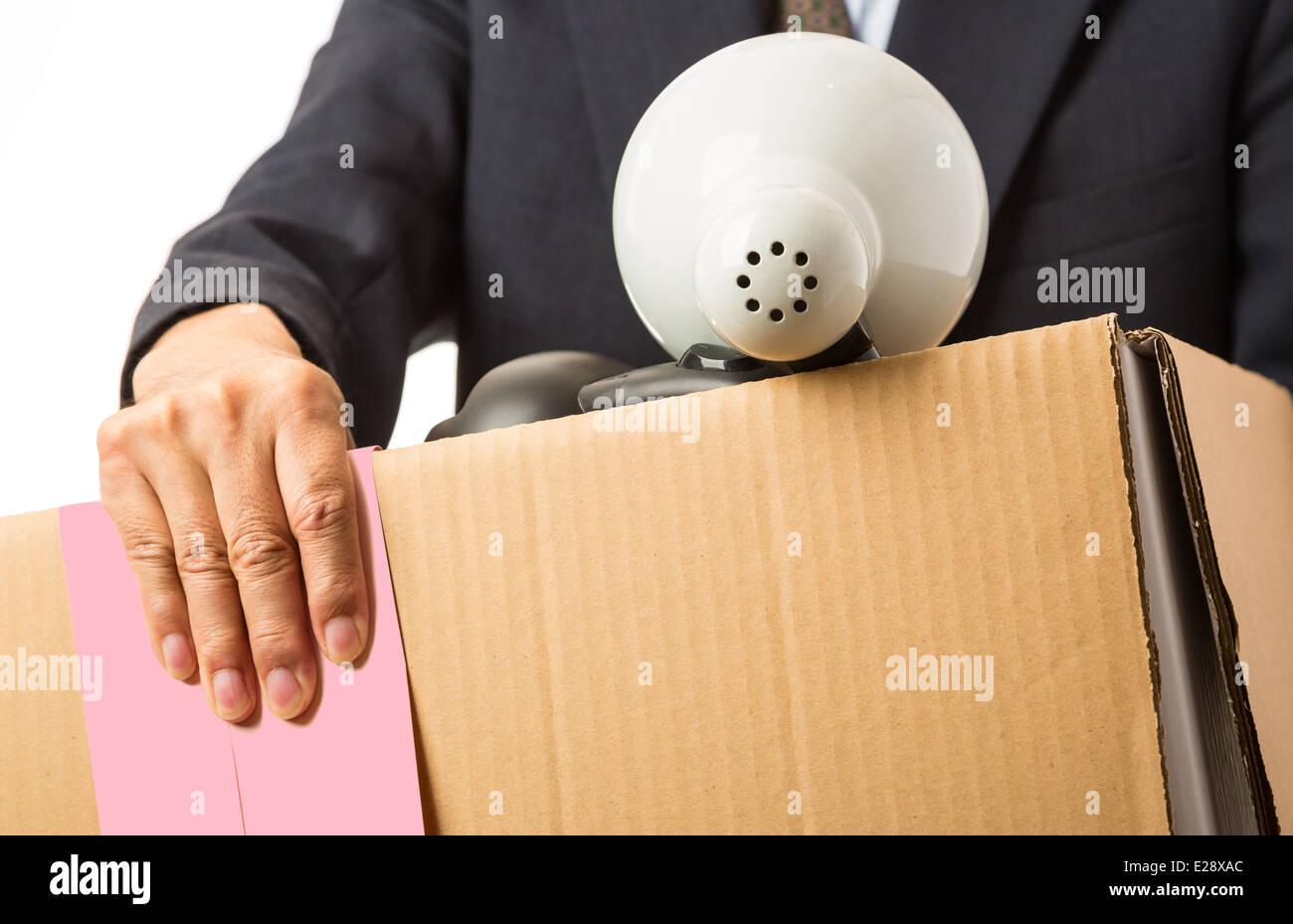 Asian man with a moving box and pink slip - Stock Image