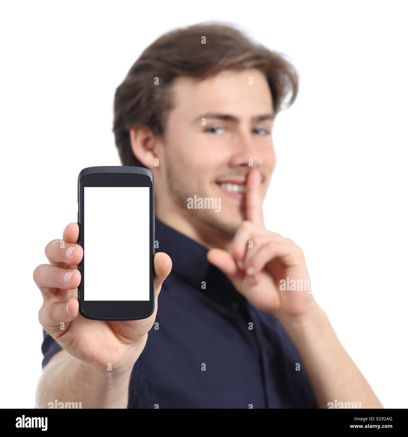 Man showing mobile phone screen and asking for silence isolated on a white background - Stock Image