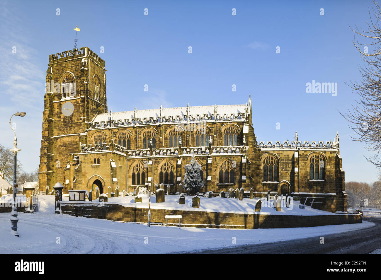 15th century church in snow on sunny day, St. Mary's Church, Thirsk, North Yorkshire, England, January - Stock Image