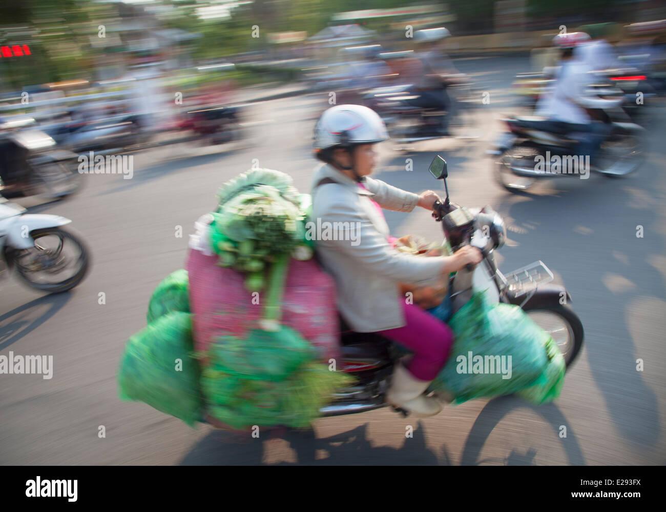 People riding motorbikes, Hue, Thua Thien-Hue, Vietnam - Stock Image