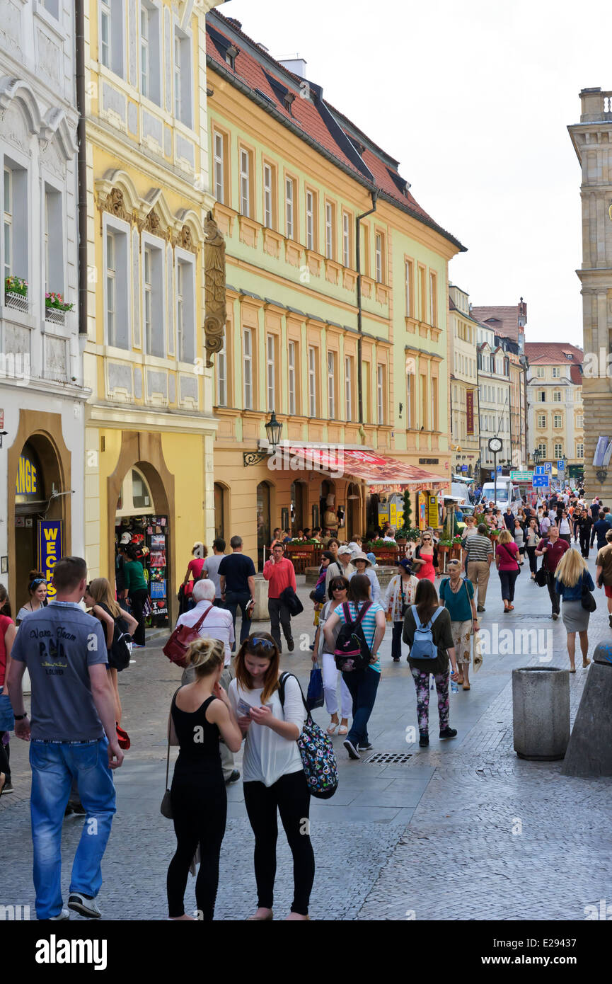 Tourists walking on one of the popular cobblestone streets in Prague, Czech Republic. - Stock Image