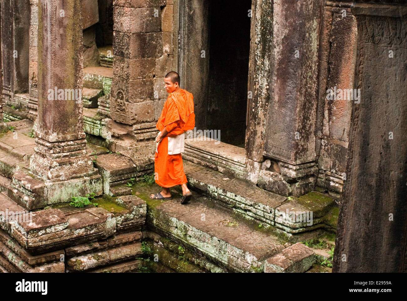 Buddhist monks in the inner part of Bayon temple. Angkor Thom. Angkor Thom was built as a square, the sides of which Stock Photo