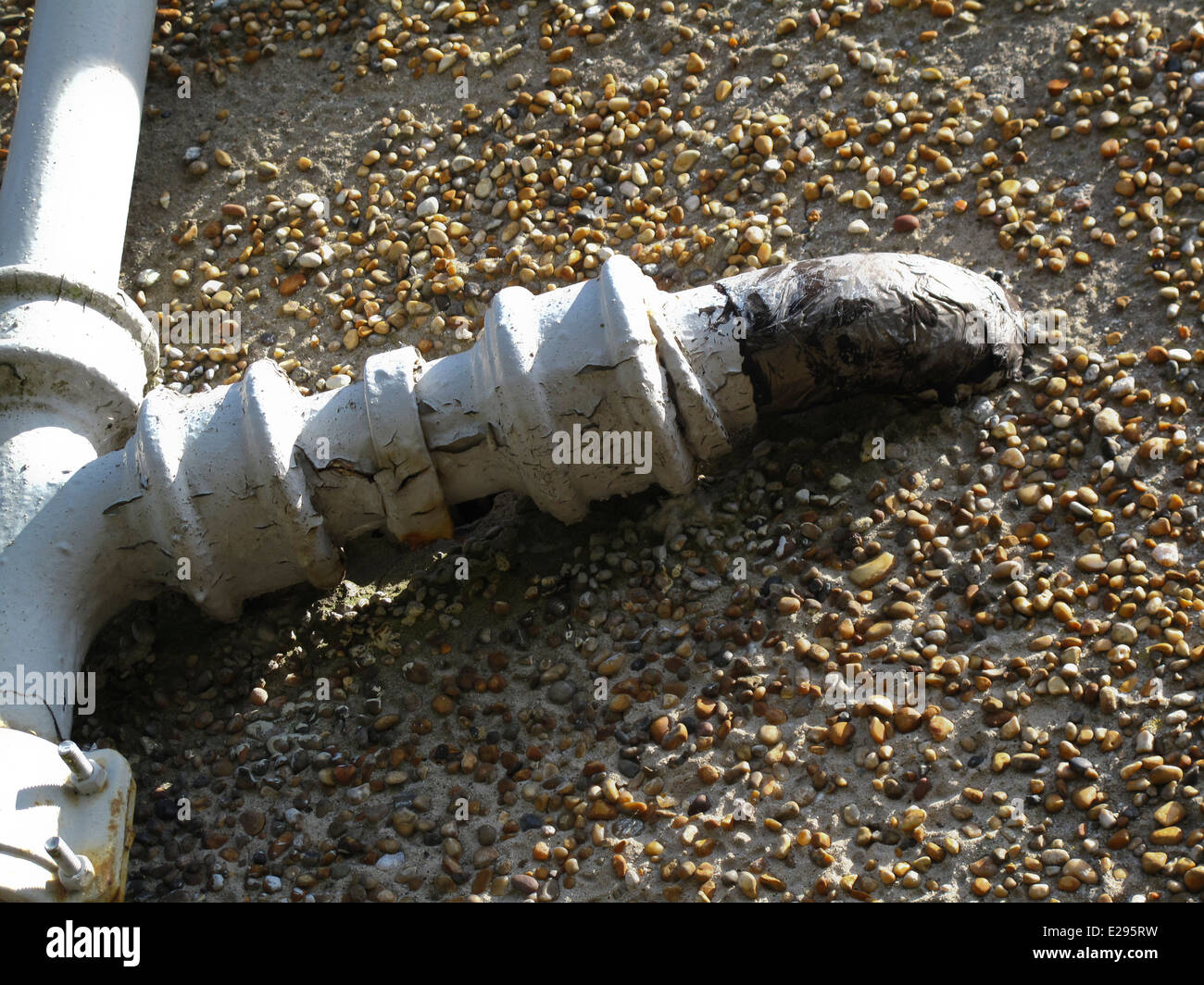 Corroded and repaired cast iron waste pipe on house & Corroded and repaired cast iron waste pipe on house Stock Photo ...
