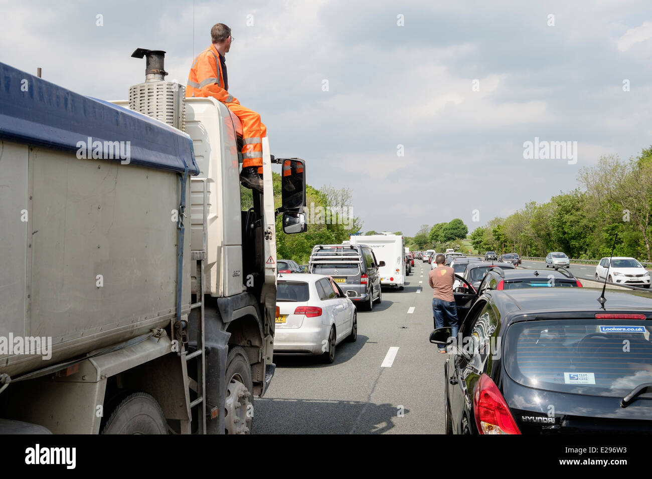 Stationary vehicles in a traffic jam on M6 motorway due to an accident causing a long delay. England UK Britain - Stock Image