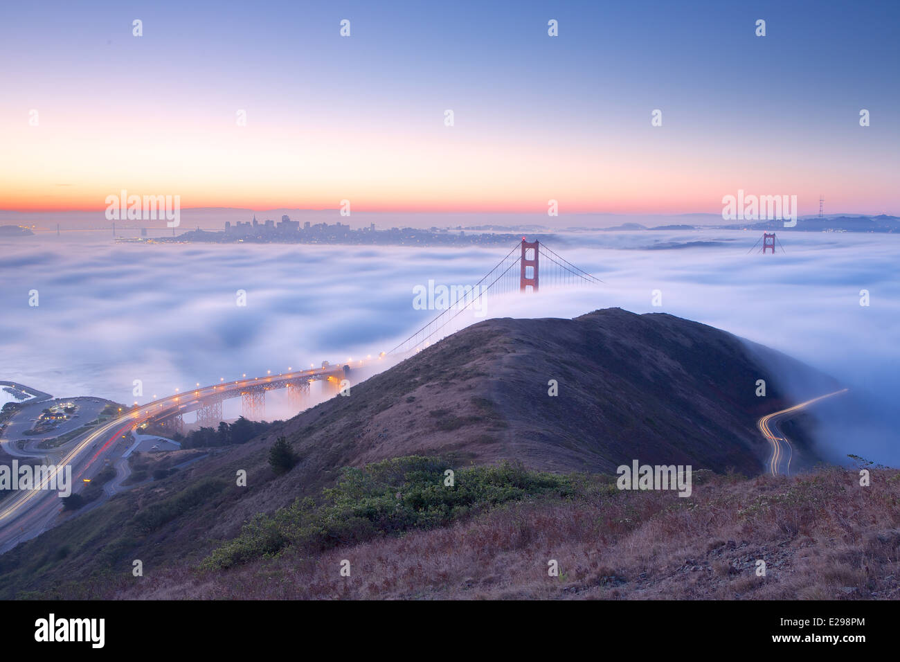 A beautiful fog blanket sweeps into San Francisco Bay before sunrise, with views of Marin Headlands, and the Golden - Stock Image