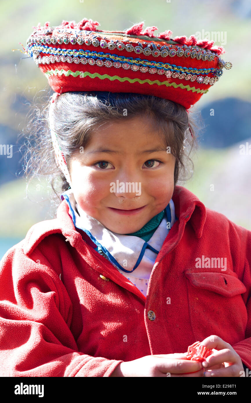 Norma, a small girl of the Huacawasi Valley high in the Andes, wearing her traditional Quechua hat. - Stock Image