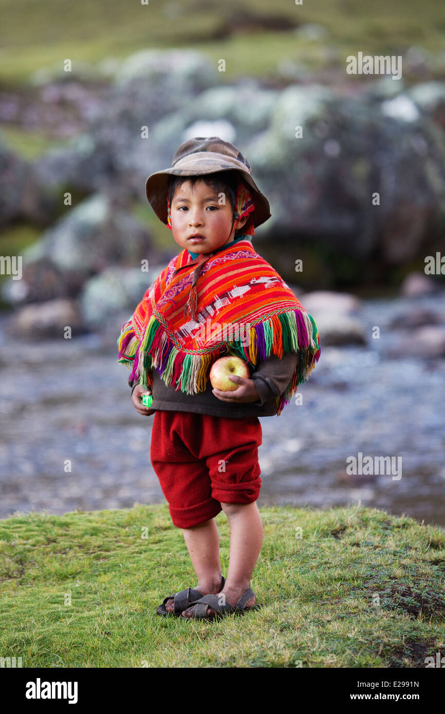 A young Quechua boy living in the Lares Valley high in the Andes in Peru, South America. - Stock Image