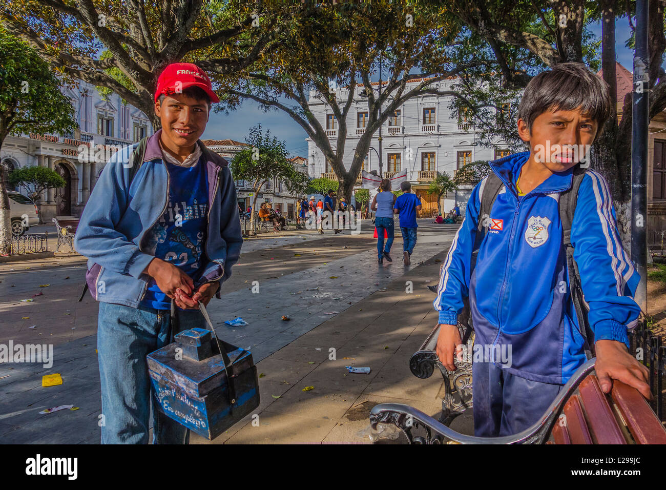 Two young shoe shine boys at the 25th of May Plaza, the main plaza in Sucre, Bolivia. - Stock Image