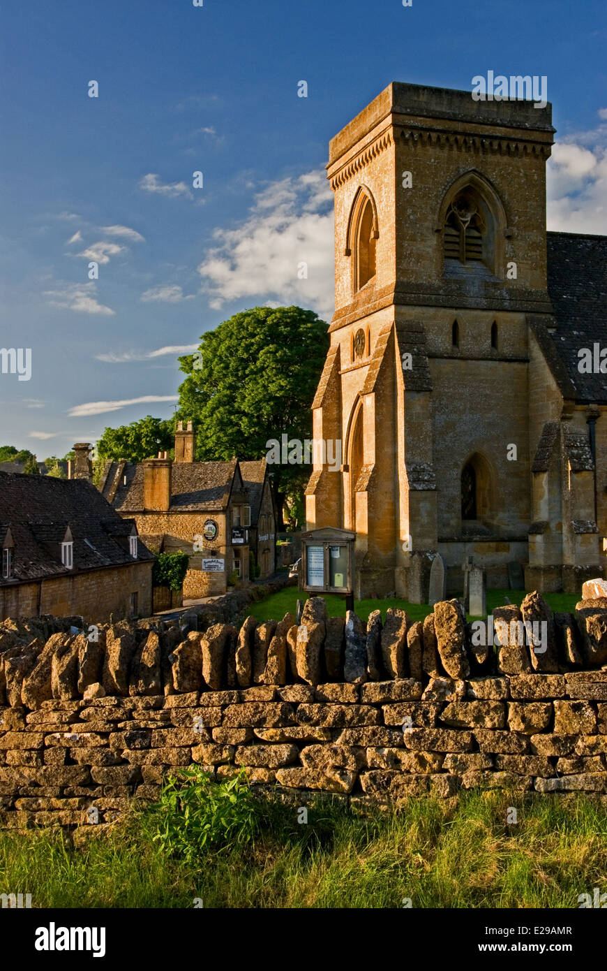 Snowshill village in the Northern Cotswolds is a typical picturesque English village with the small church at its - Stock Image
