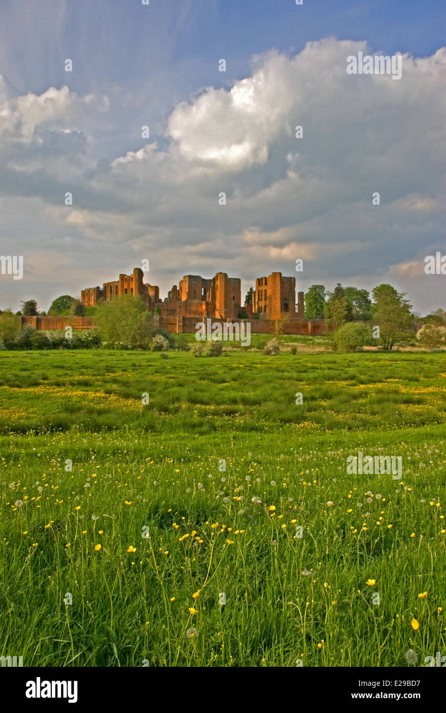 The ruins of Kenilworth Castle in Warwickshire can be seen from across farmland that once formed part of the moat. - Stock Image
