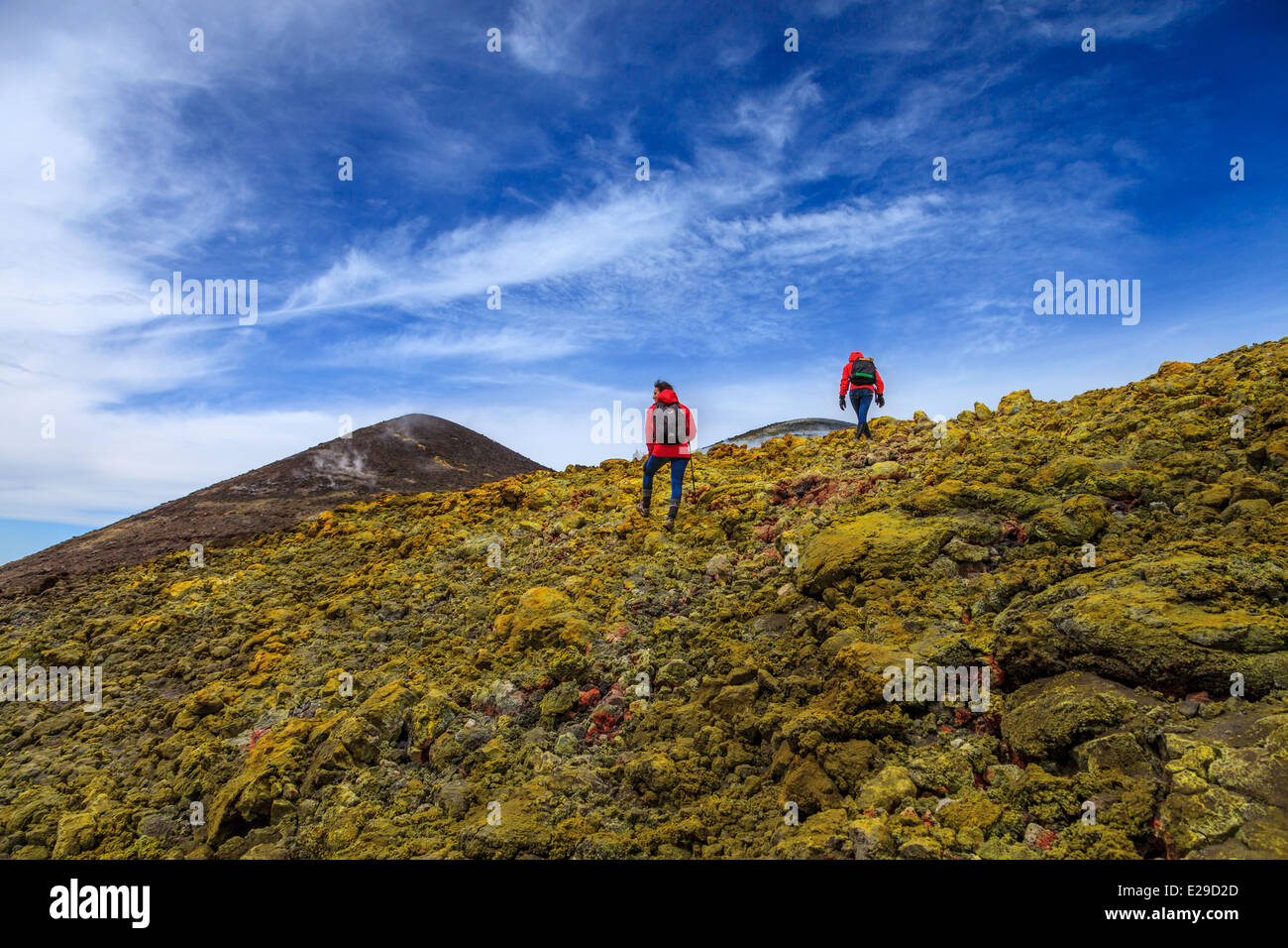Hikers reaching summit of Mount Etna - Stock Image