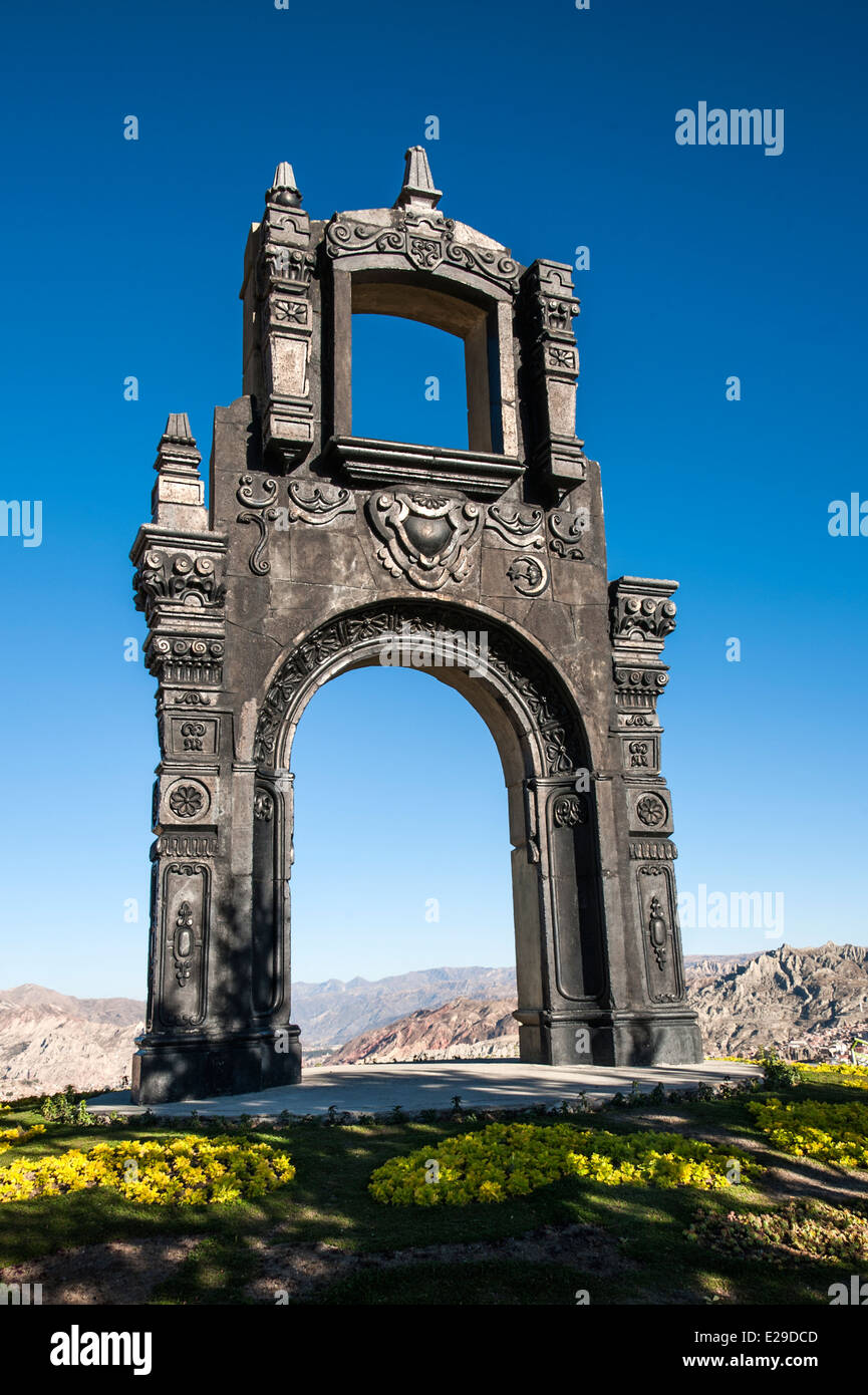 Ancient Ornate arch on top of Cerro Quilli, La Paz from above, with Nevado Illamani in the distance. Bolivia - Stock Image