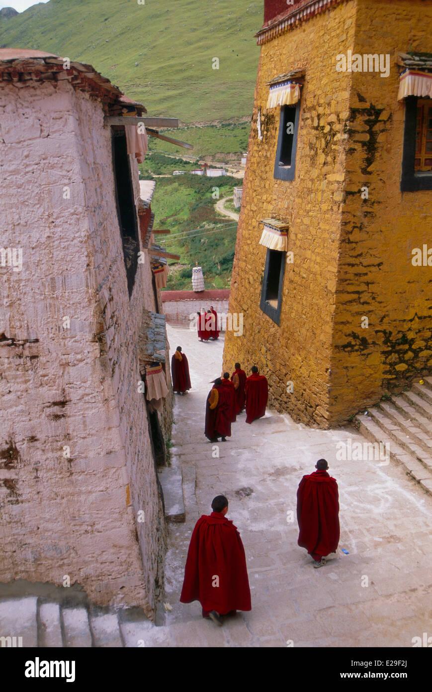 Tibetan monks walking to a ceremony, Ganden Monastery, Tibet Stock Photo