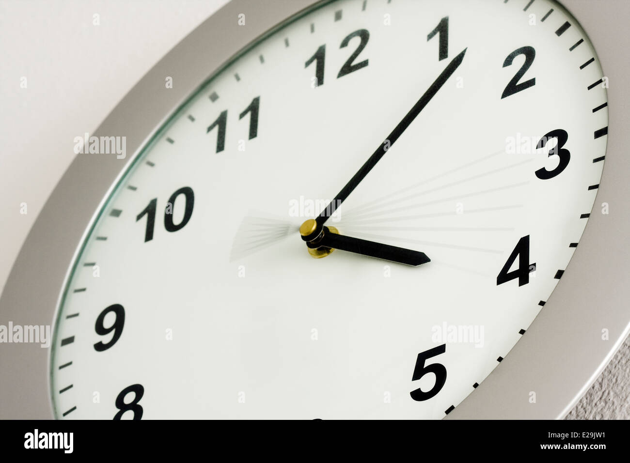 The time of 4:08 showing on a white analog clock face depicting the passing of 6 seconds by the movement of the - Stock Image