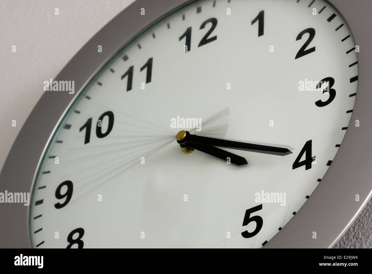 Grey Wall Clock showing the time of 4:20 - Stock Image