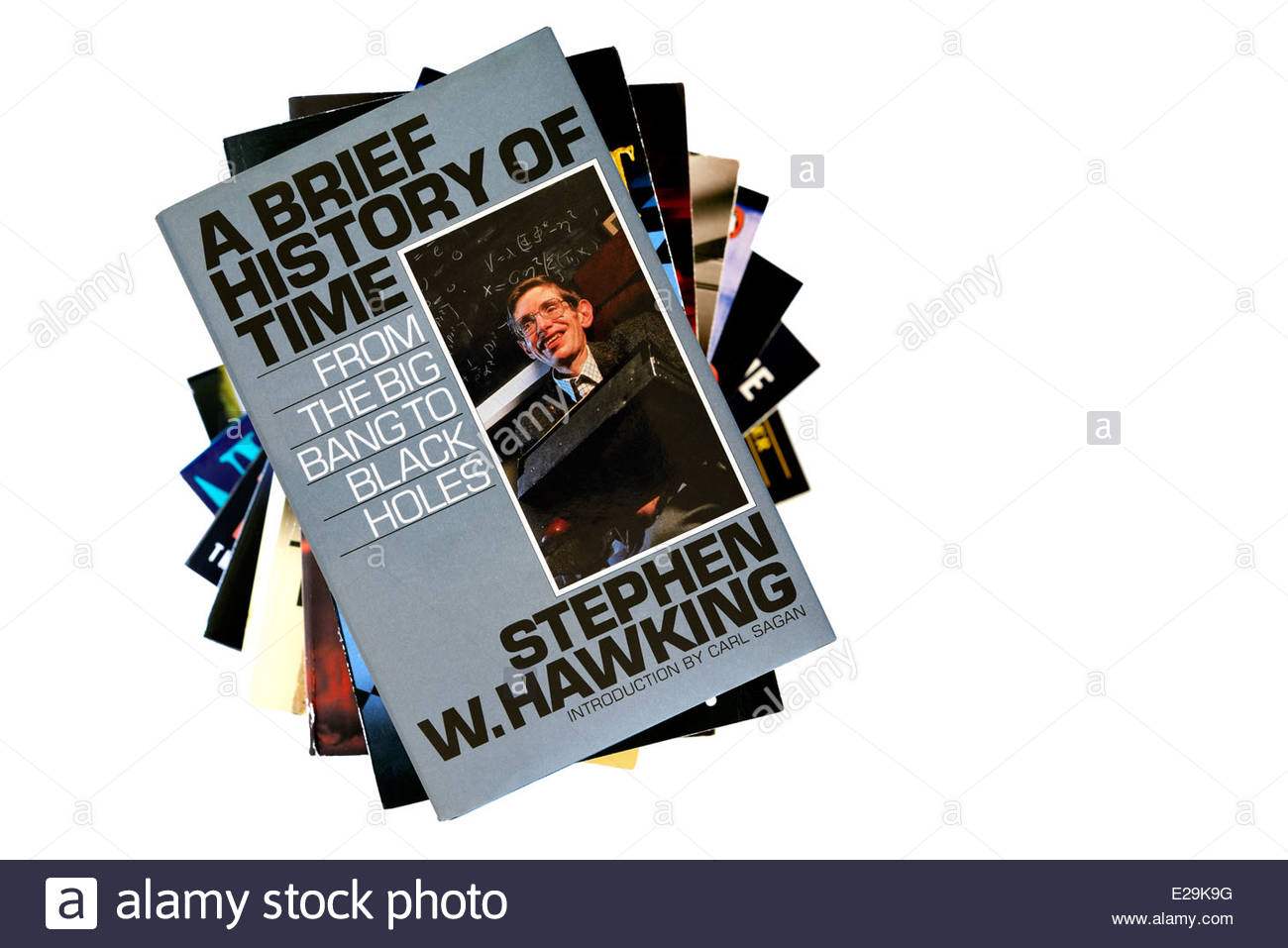 Stephen Hawking book title A Brief History Of Time, stacked used books, England - Stock Image