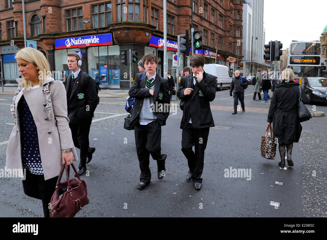 United Kingdom, Northern Ireland, Belfast, schoolchildren in uniforms after school on Donegall Square - Stock Image