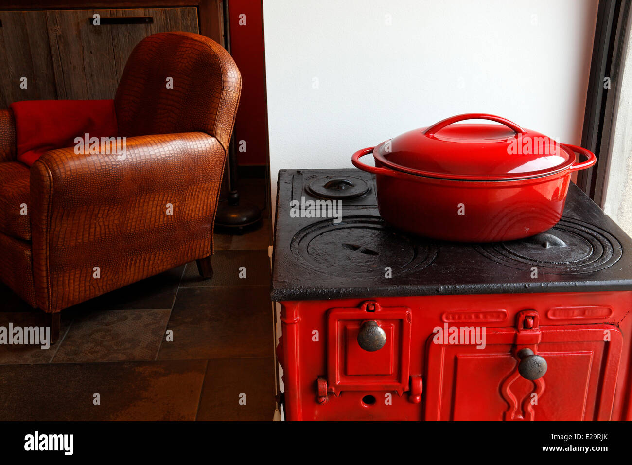 France, Morbihan, Baden, Le Val de Brangon, guest house top of the range, old stove and leather easy chair - Stock Image