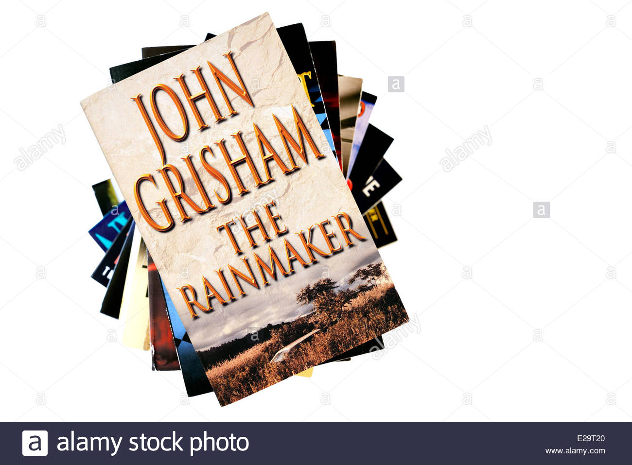 John Grisham book title The Rainmaker, stacked used books, England - Stock Image