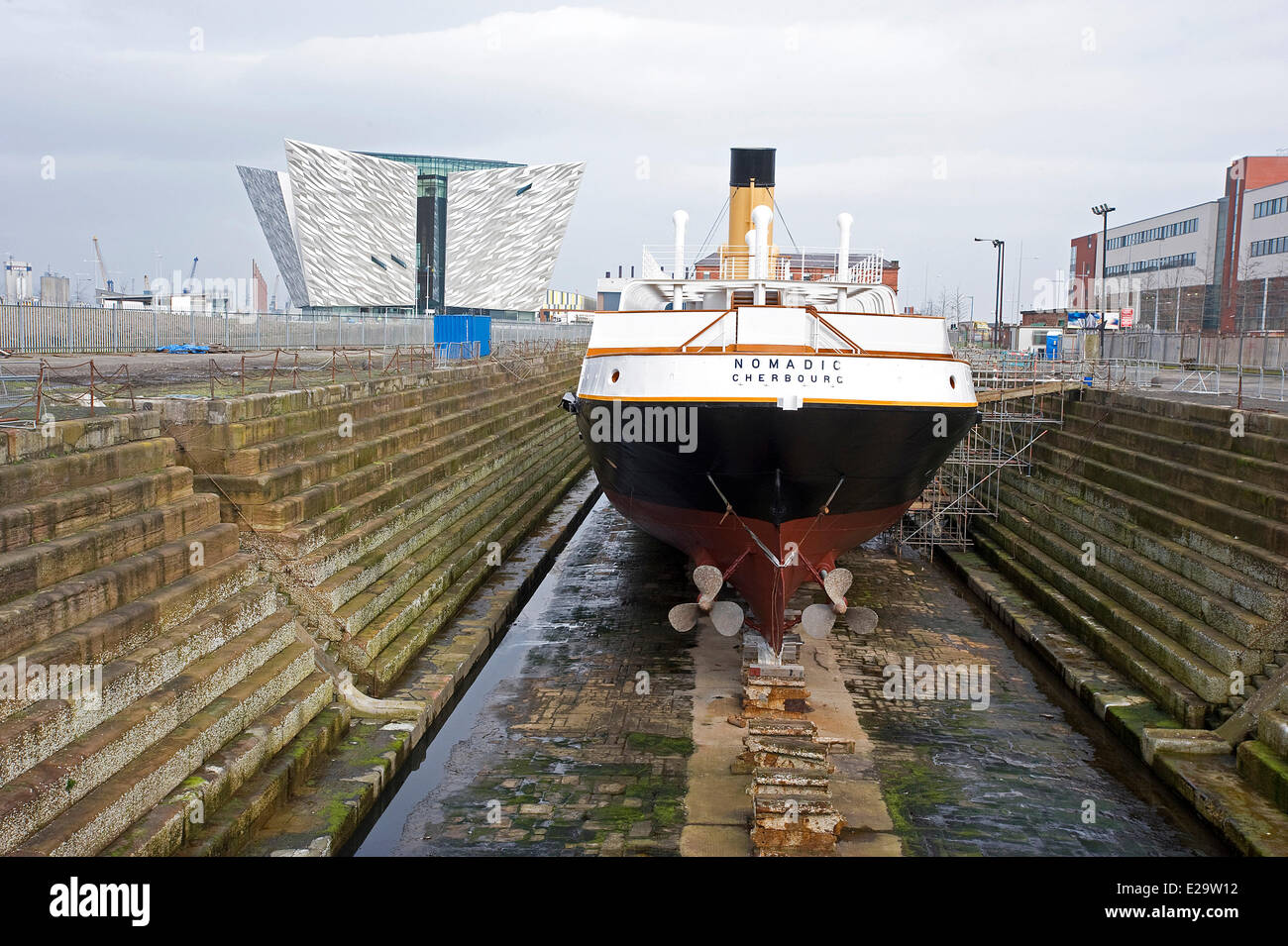 United Kingdom, Northern Ireland, Belfast, the Titanic Belfast museum and the Nomadic, the ship used to transfer - Stock Image