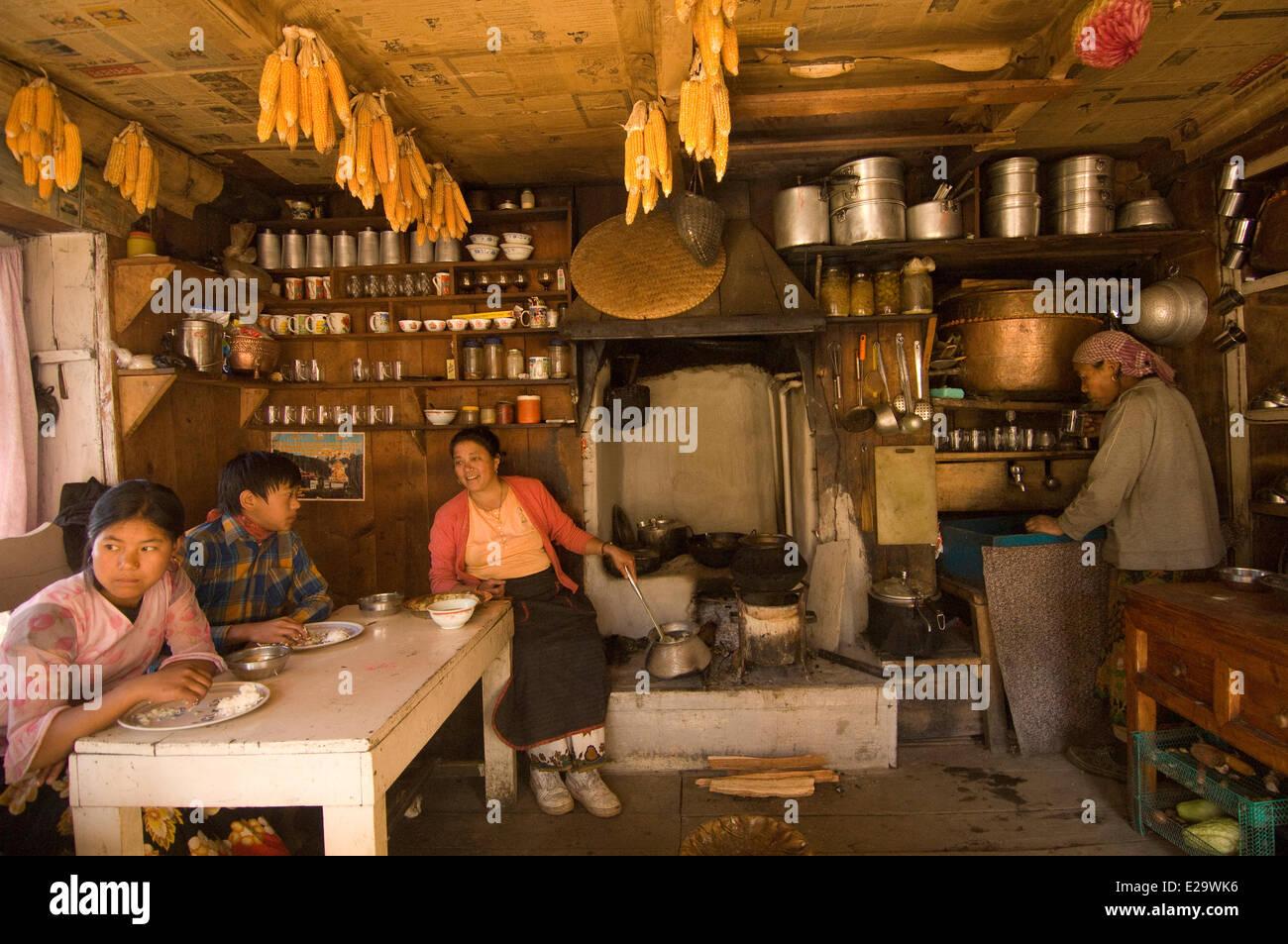 Nepal, Sagarmatha Zone, Khumbu Region, trek of the Everest Base Camp, Bupsa, lunch time in a sherpa house - Stock Image