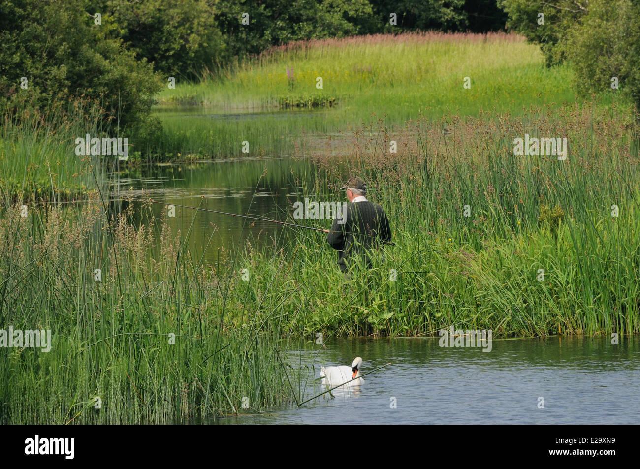 Ireland, County Mayo, Cong, Fisherman fishing in Cong river - Stock Image