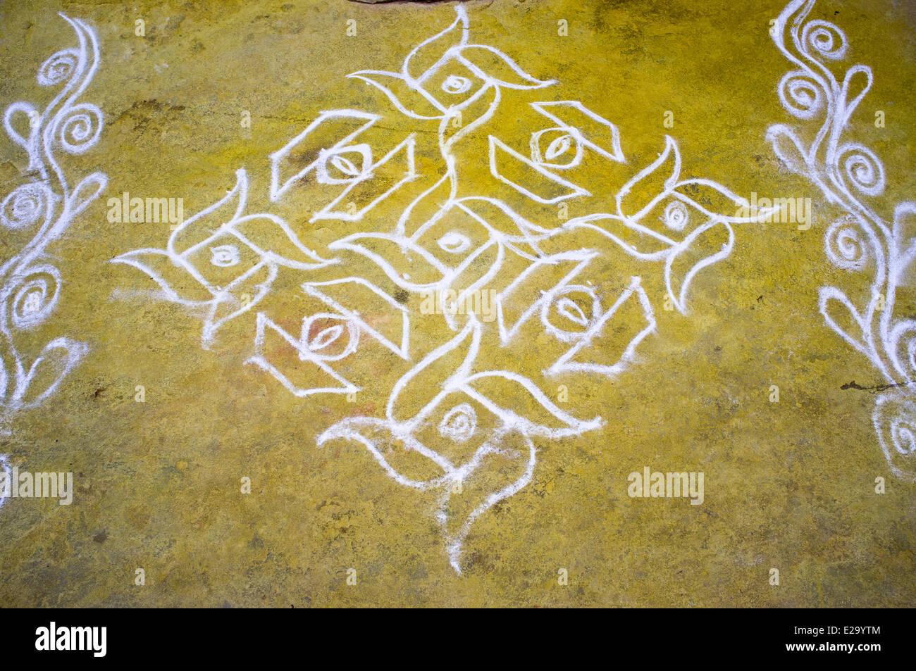 India, Tamil Nadu State, Mahabalipuram, a rangoli drawn on a doorstep with rice powder to ward off evil spirits Stock Photo