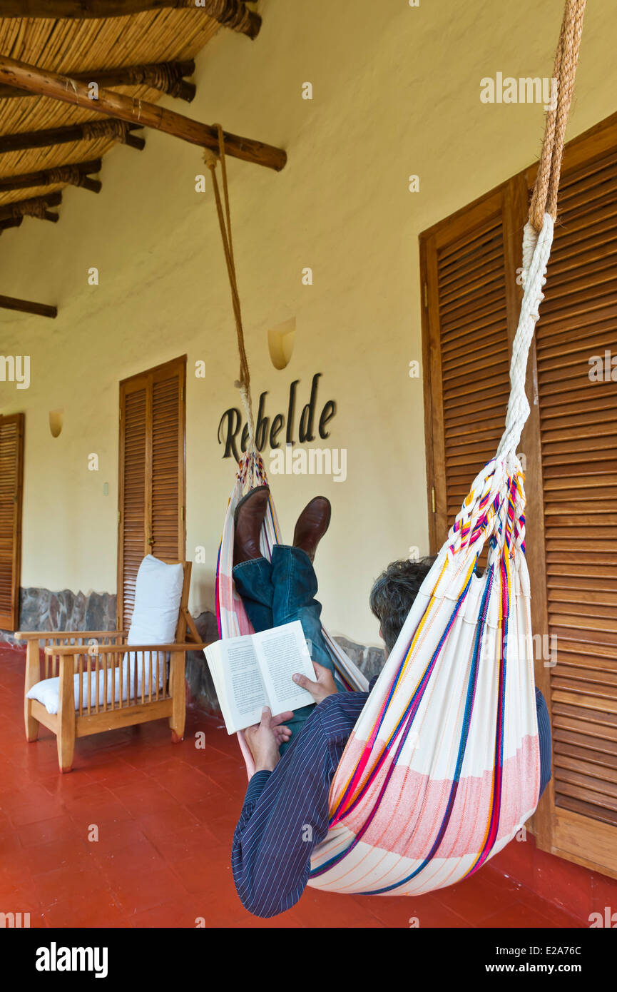 Peru, Cuzco Province, Huasao, hammock on the terrace of a bungalow in the Hacienda of Ninos Hotel is one of the - Stock Image