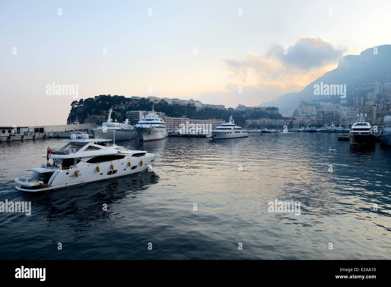 Principality of Monaco, Monaco, Port Hercule and the Rock in the background - Stock Image