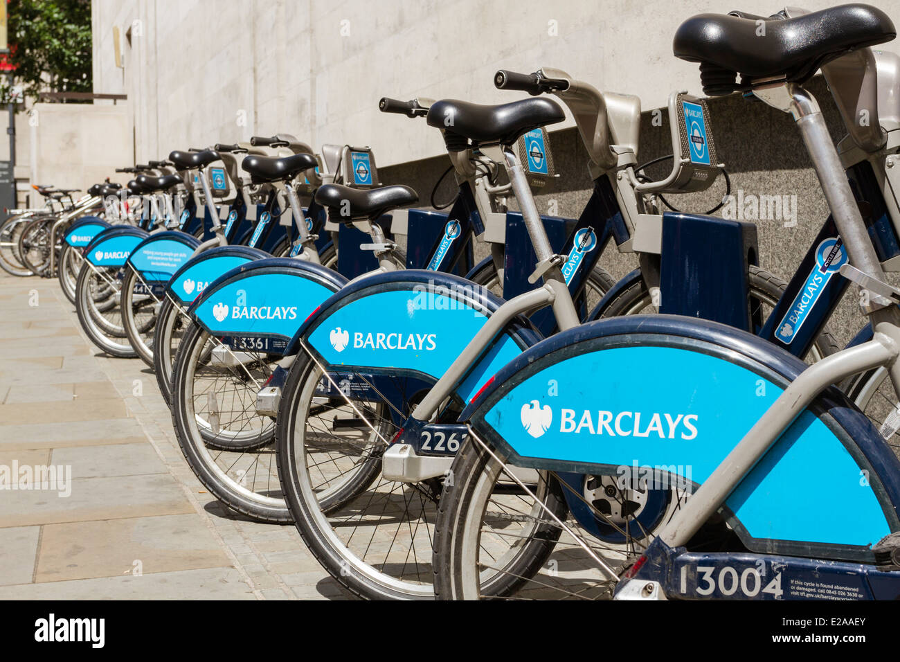 Barclays Cycle Hire,cycle hire scheme, aka Boris bikes lined up at docking station, London, England, UK - Stock Image