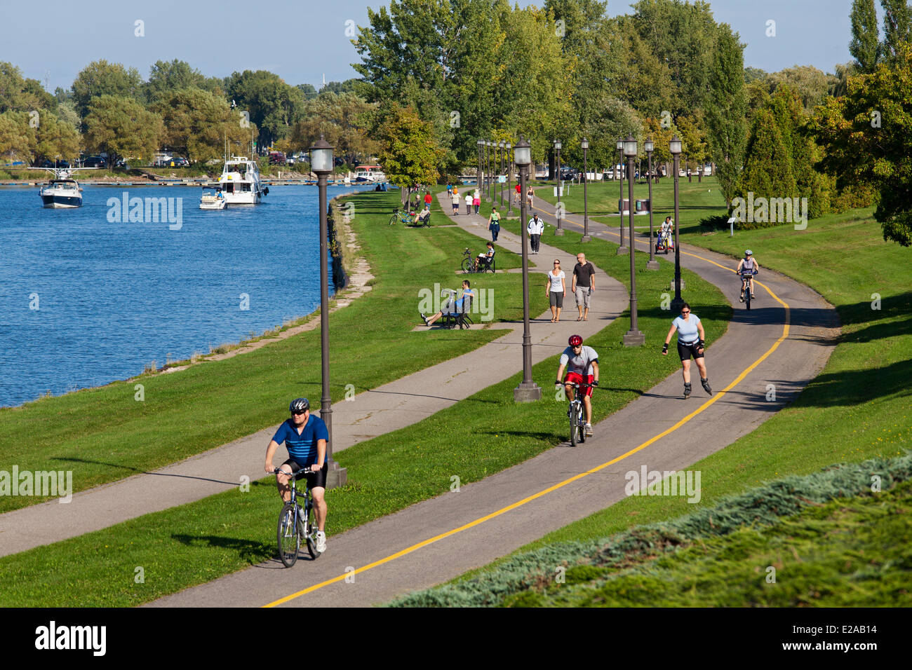 Canada, Quebec Province, Montreal, Lachine, Rene Levesque Park, bicycle and pedestrian path alongside the canal Stock Photo
