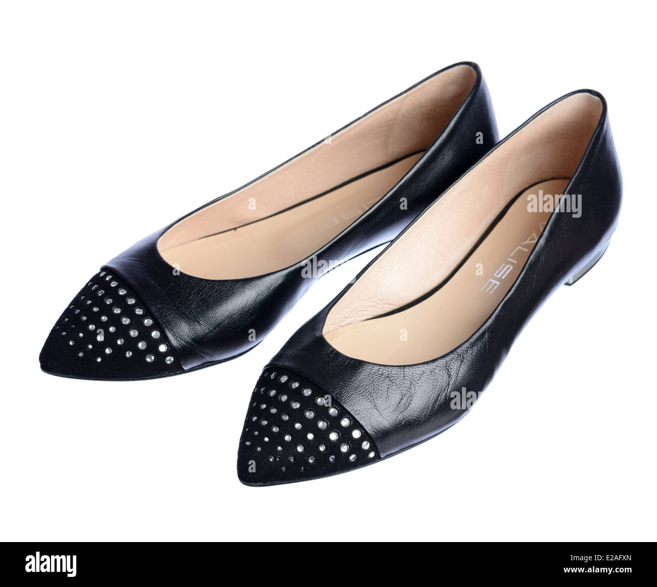4343d7db8 Pair of black leather flat shoes isolated on white background - Stock Image