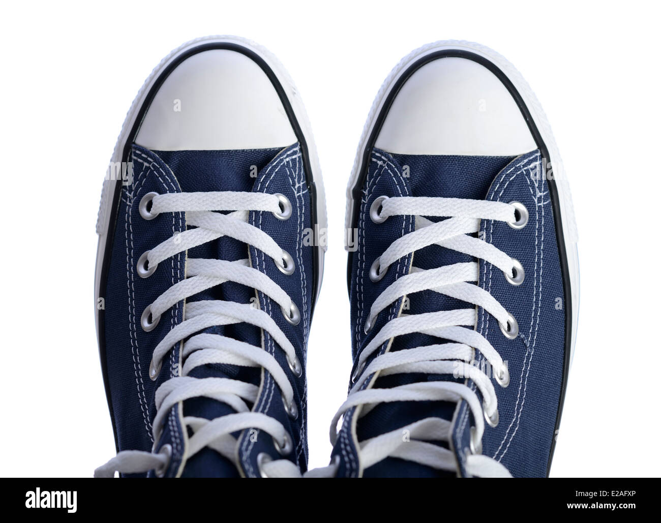 Blue canvas sneakers from above - Stock Image