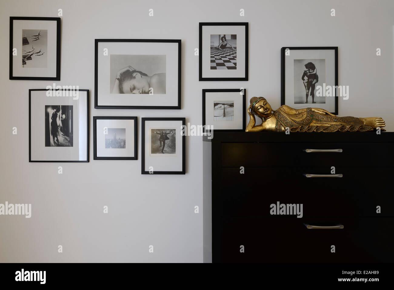 Framed photos on a wall - Stock Image