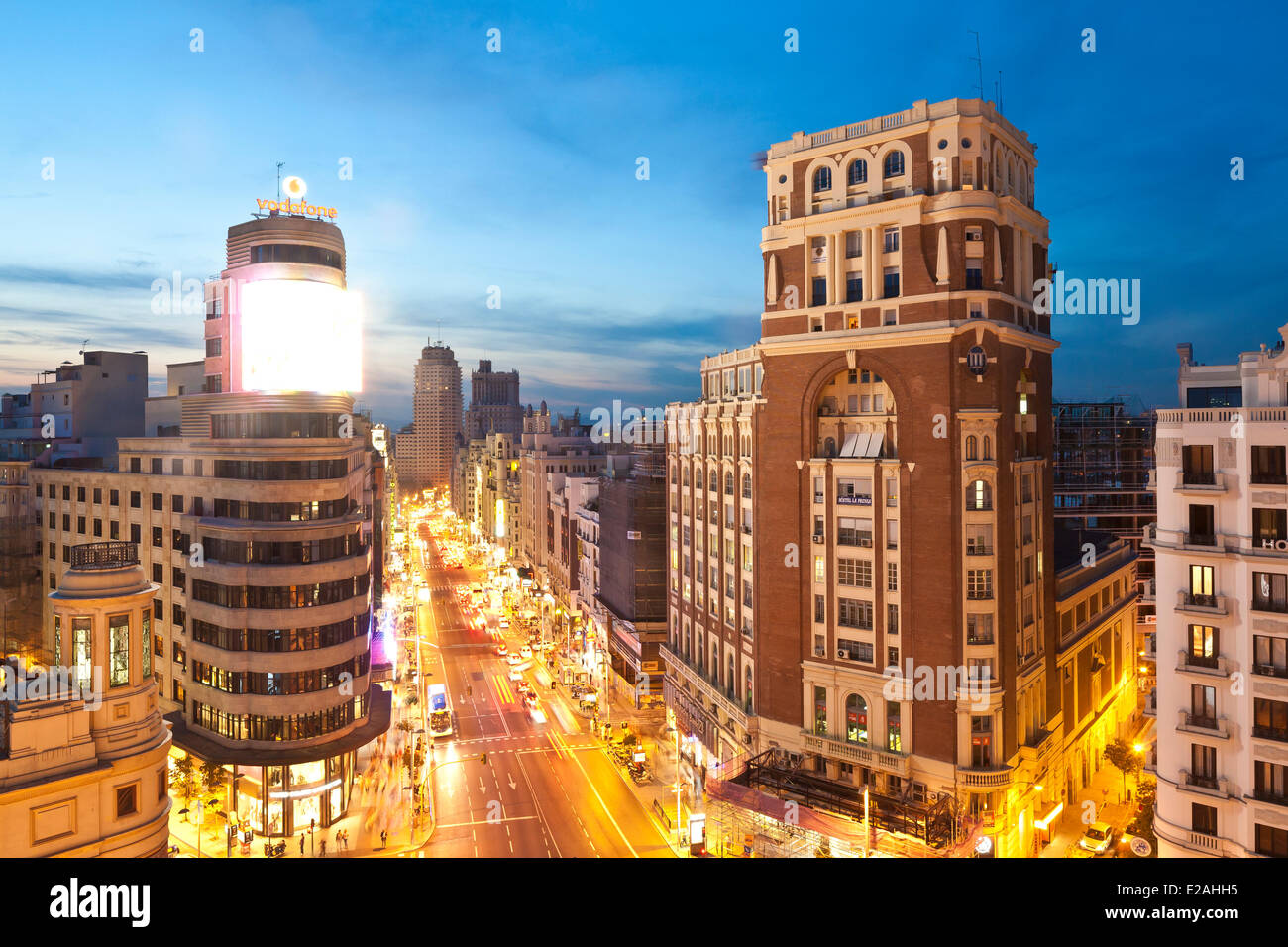 Spain, Madrid, Gran Via view with Carrion edifice on left designed by architects Luis Martinez-Vicente and Feduchi - Stock Image