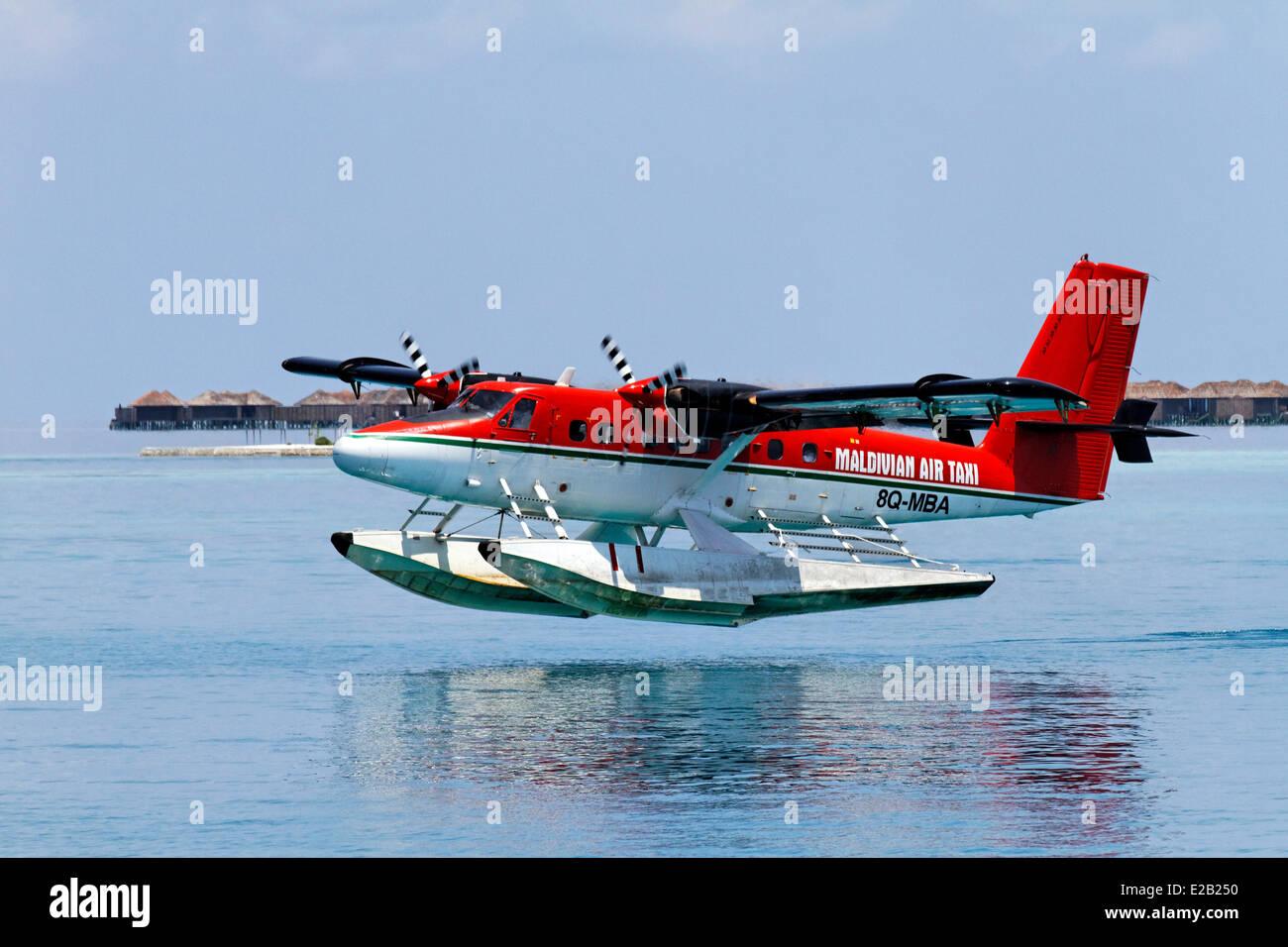 Maldives, seaplane of Maldivian Air Taxi company, planing - Stock Image
