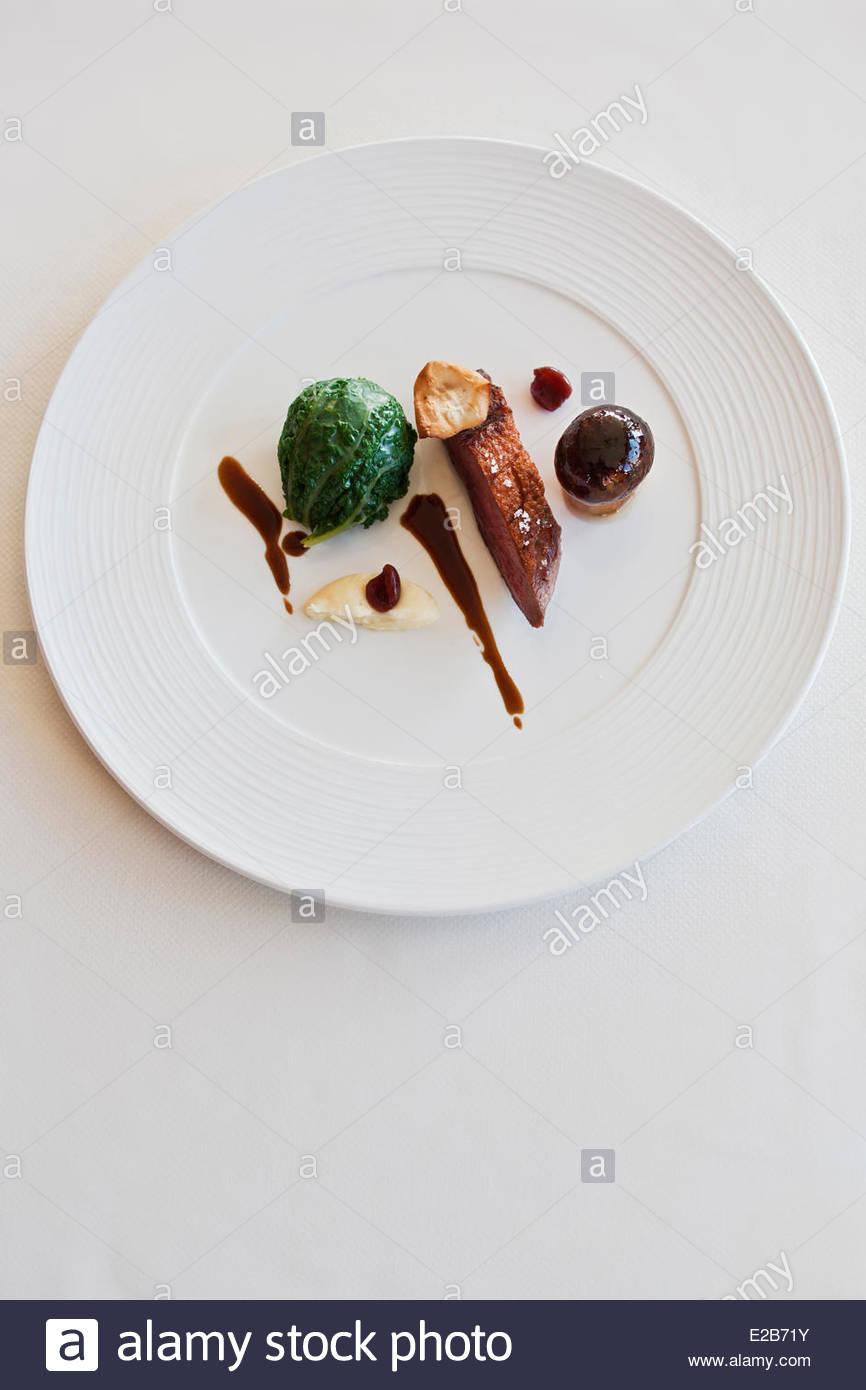 France, Morbihan, Billiers, Bobbin cross, stuffed cabbage and mushroom cap, tangy juice with cherries, recipe Patrice - Stock Image