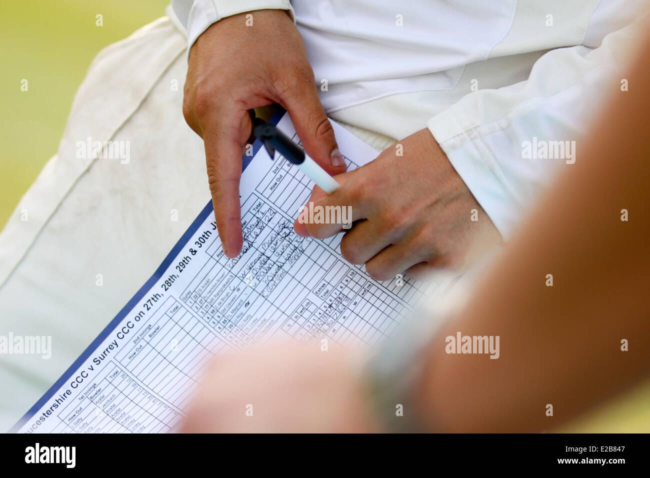 Hand signing autograph at Cheltenham Cricket Festival - Stock Image