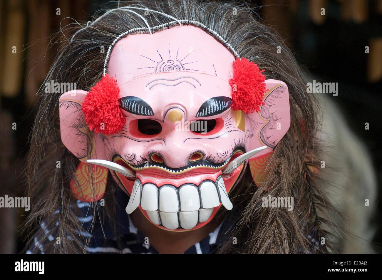 Indonesia, Bali, Ubud, market man wearing a painted mask - Stock Image