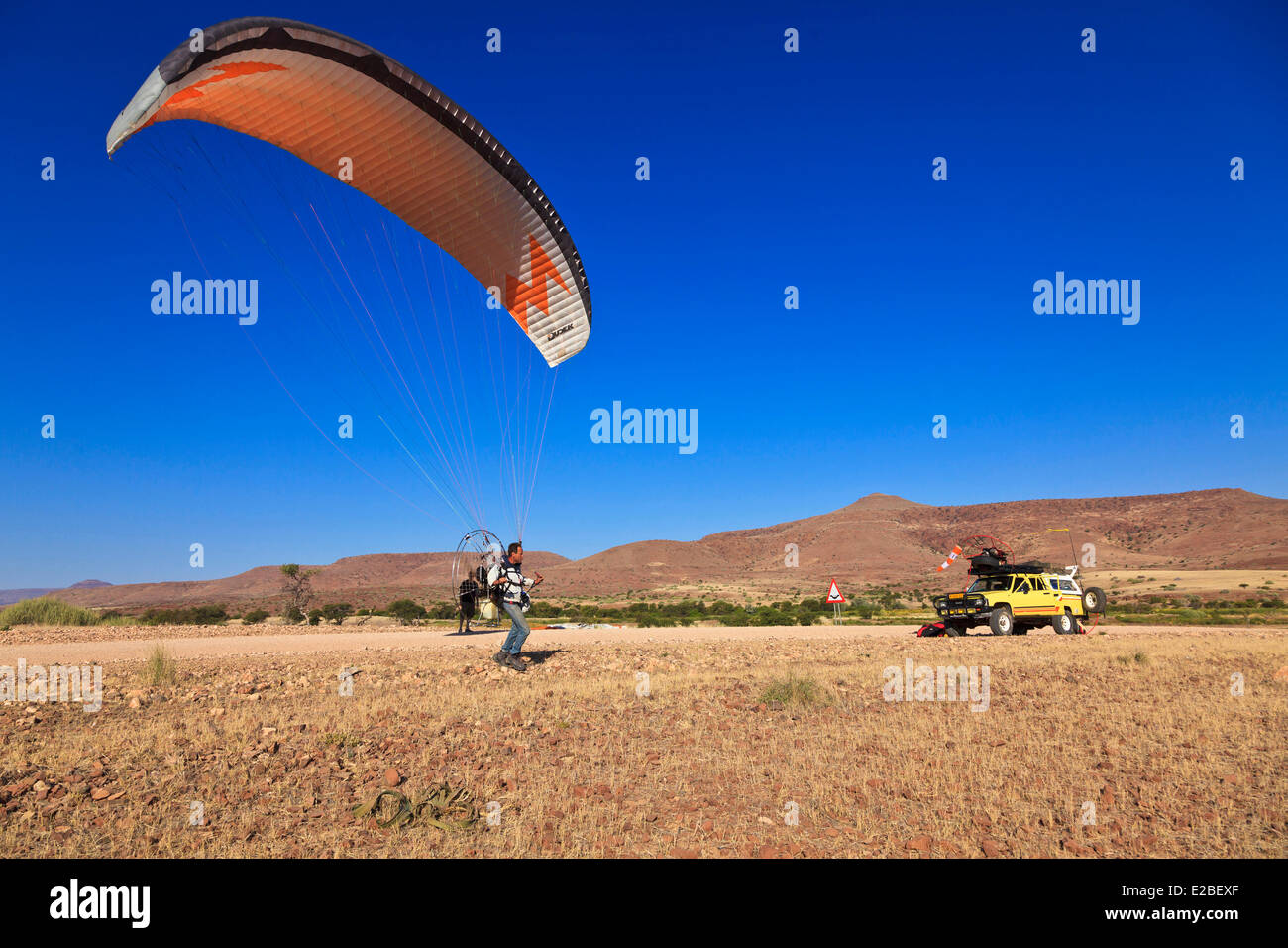 Namibia, Damaraland, near Palmwag, takeoff of paramotor - Stock Image