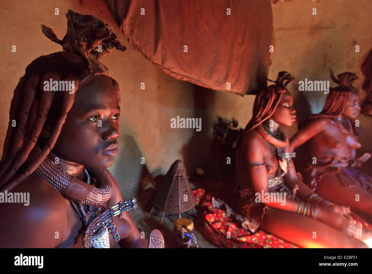 Namibia, Kunene Region, Kaokoland or Kaokoveld, Himba women in a village, Bantu ethnic group, body covered with - Stock Image