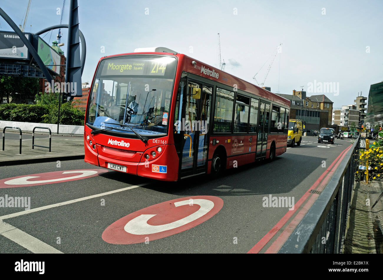 Low decker bus entering congestion charge zone, Old Street Roundabout, London Borough of Islington, Engand UK - Stock Image