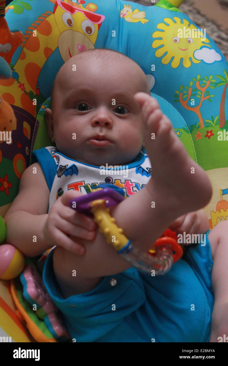 baby is playing a toy - Stock Image