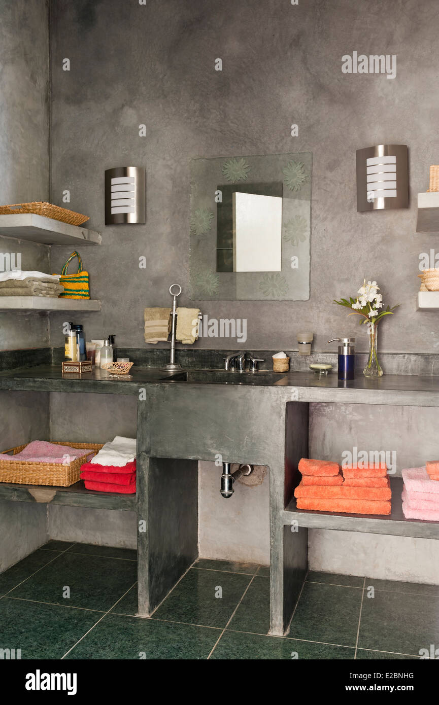 Grey bathroom with polished cement surfaces in Baja home of English interior designer Jenny Armit Stock Photo
