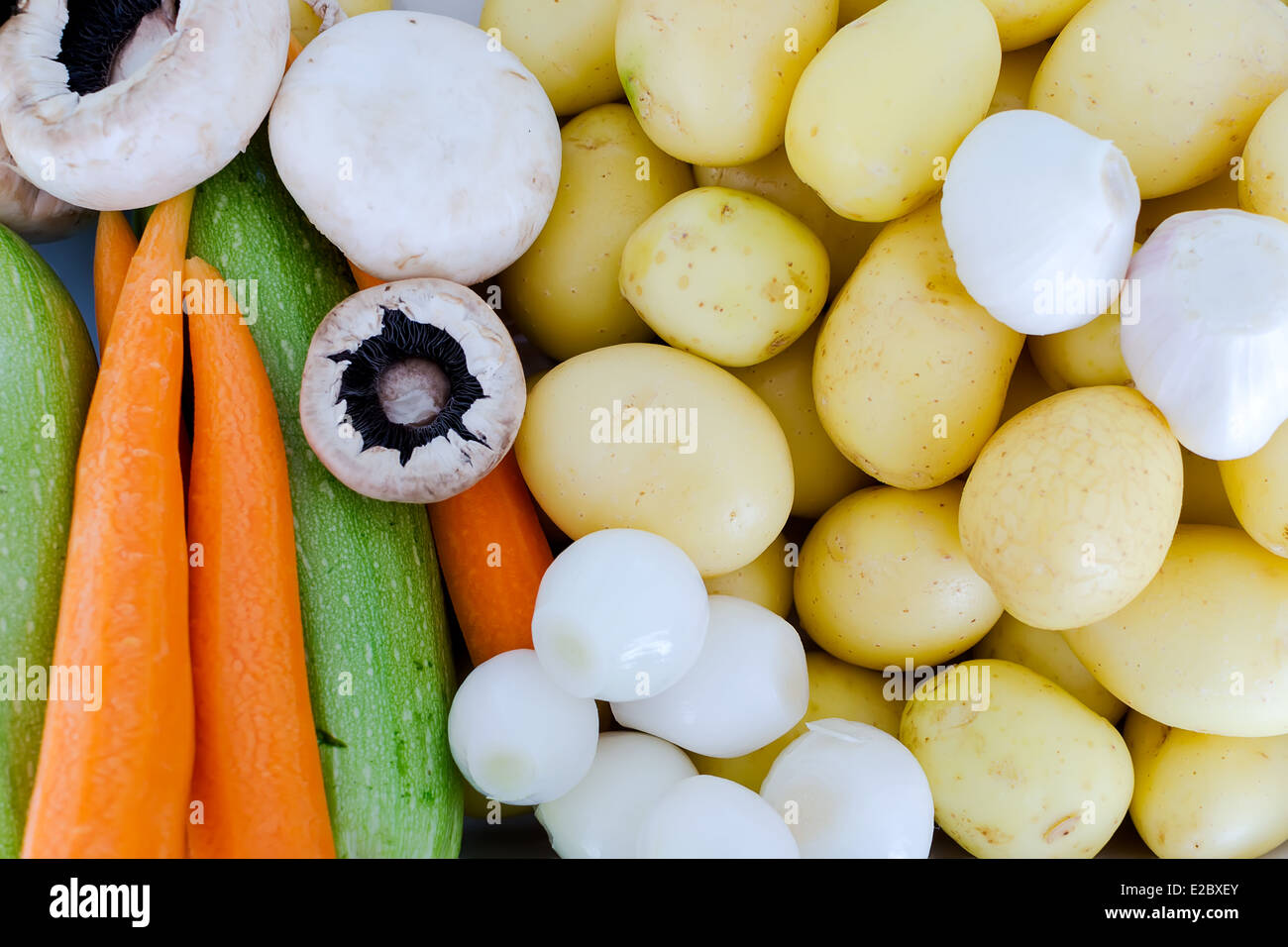 Fresh potatoes on a baking with vegetables - Stock Image